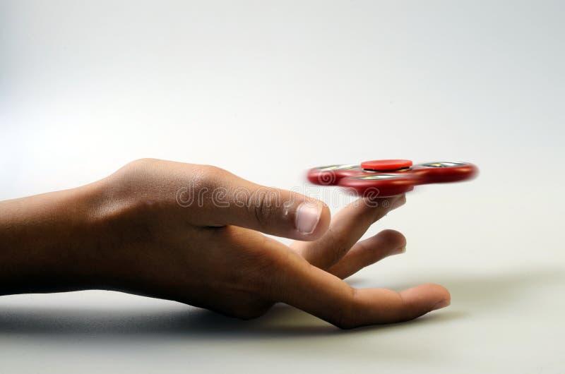 Fileur de main, jouet remuant de main images libres de droits
