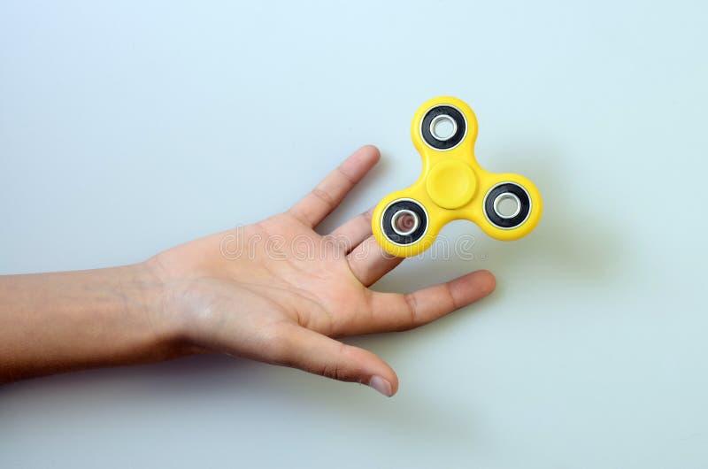 Fileur de main, jouet remuant de main photographie stock libre de droits