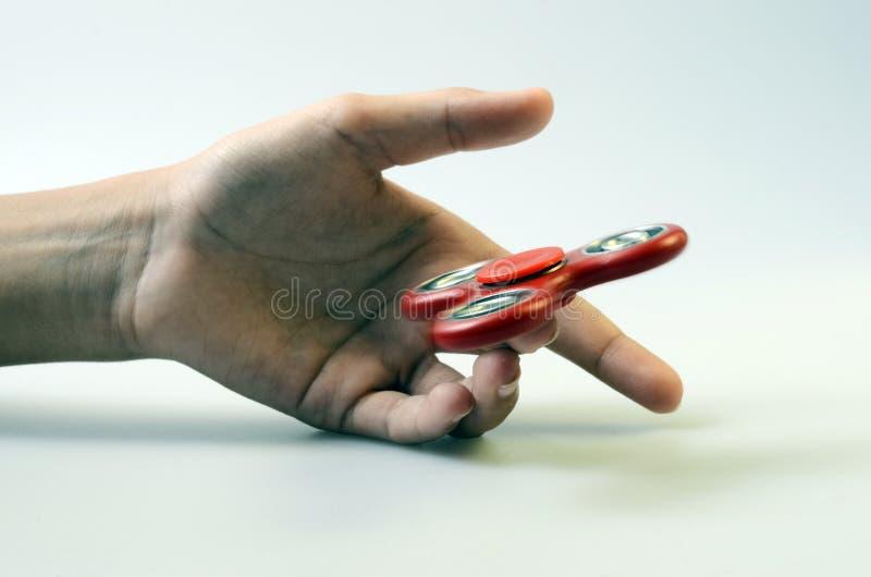 Fileur de main, jouet remuant de main photo stock