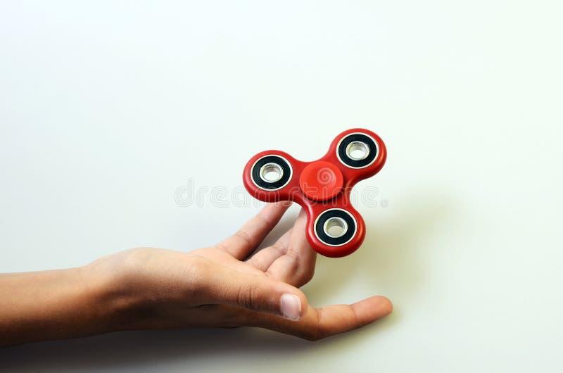 Fileur de main, jouet remuant de main images stock