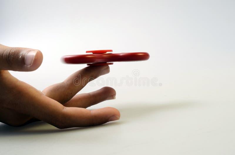 Fileur de main, jouet remuant de main image stock