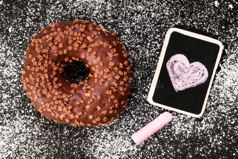 Filhós com o desenho do chocolate e do coração, imagens de stock