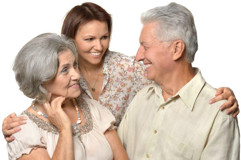 Filha adulta com pais superiores imagens de stock royalty free