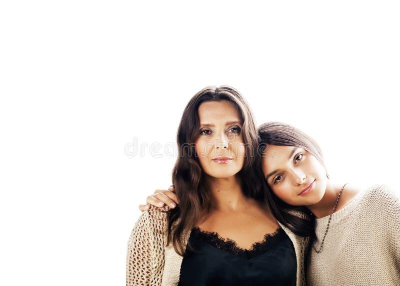 Filha consideravelmente adolescente bonito com a mãe madura real que abraça, fashi imagem de stock royalty free