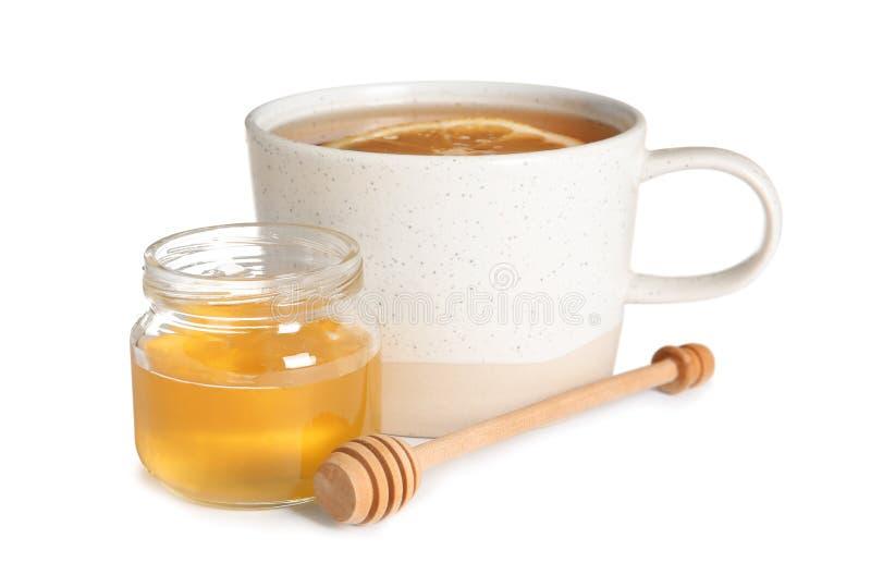 Filiżanka gorąca herbata z cytryną i miodowym słojem obrazy royalty free