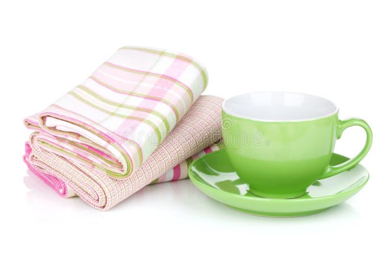 Filiżanka i kuchenni ręczniki obrazy stock