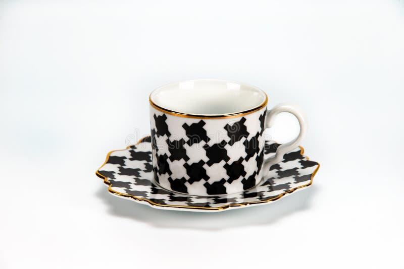 Filiżanka i spodeczek z czarny i biały wzorem zdjęcie royalty free