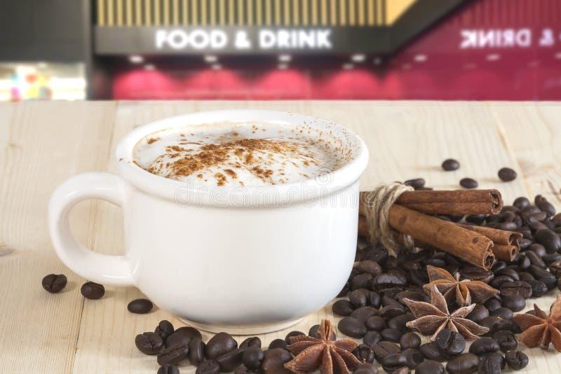 Download Filiżanka kawy na brązie zdjęcie stock. Obraz złożonej z życie - 53783530