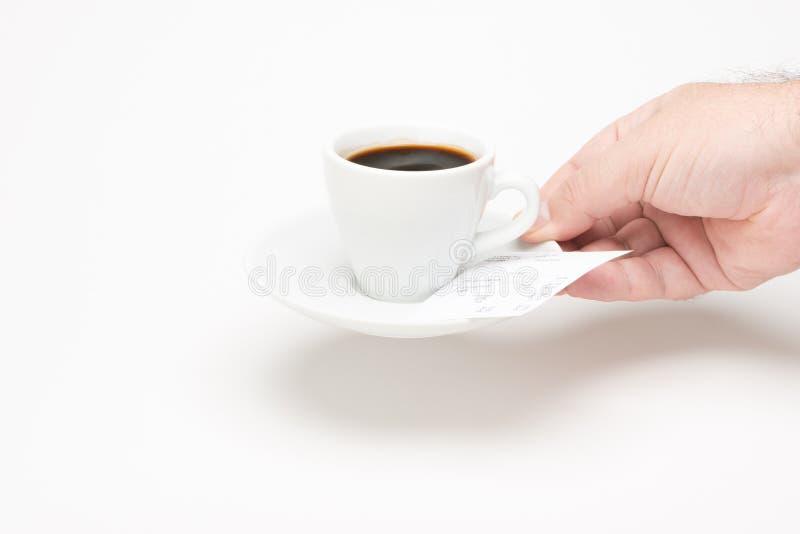 Filiżanka kawy z rachunkiem obraz stock