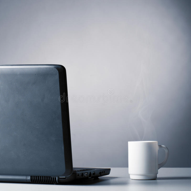 filiżanka laptop obraz stock