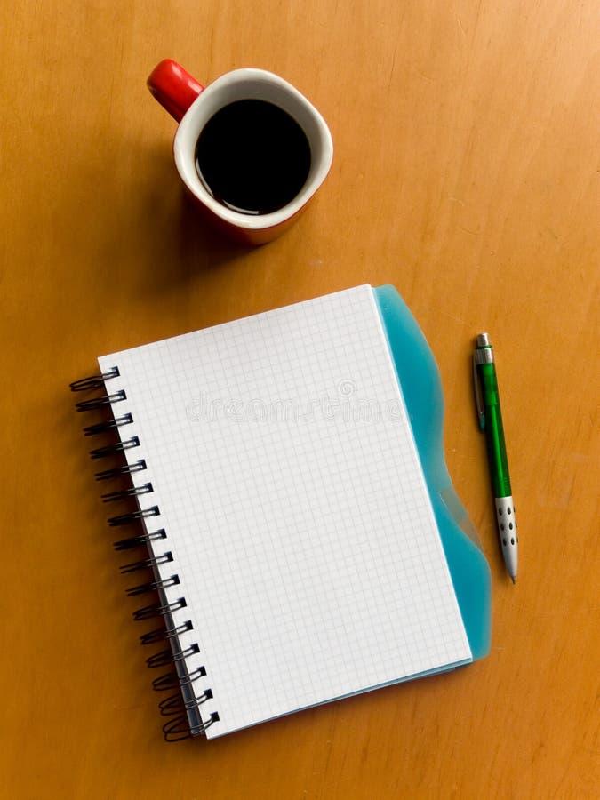 filiżanka notatnik zdjęcia stock