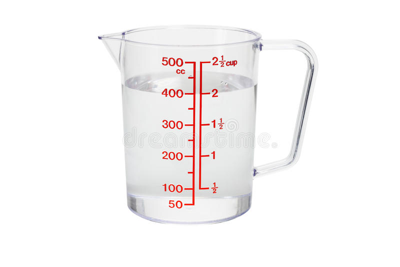 filiżanka wypełniająca kuchni pomiarowa klingerytu woda fotografia stock
