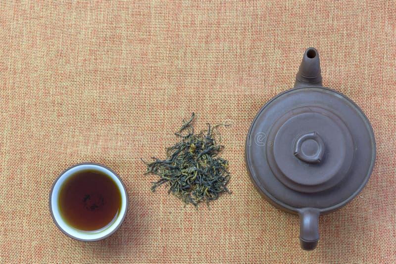 Filiżanka z herbatą i teapot, luźna herbata obraz stock