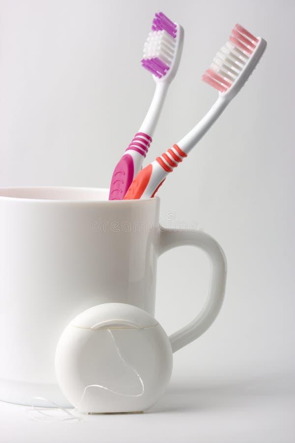 filiżanki stomatologicznego floss toothbrushes dwa zdjęcie royalty free