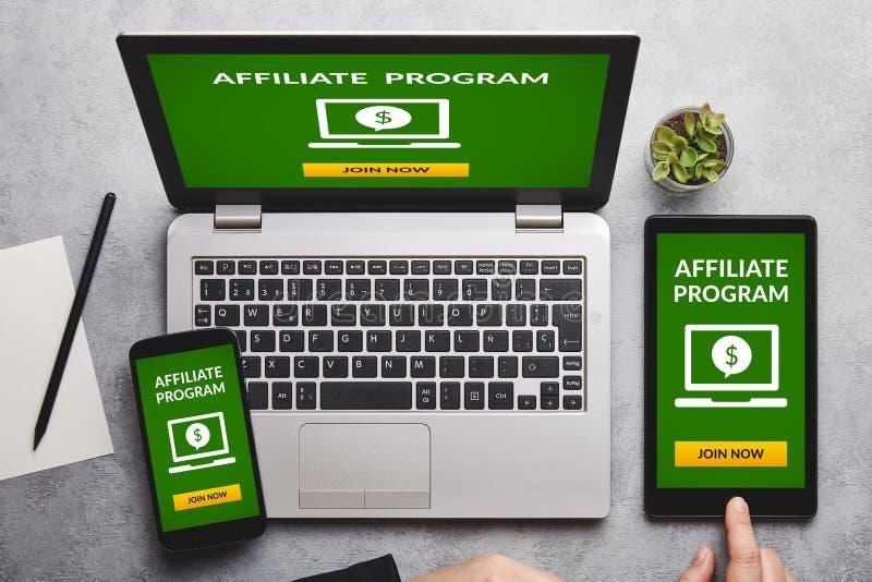Filia programa pojęcie na laptopu, pastylki i smartphone ekranie, zdjęcia royalty free