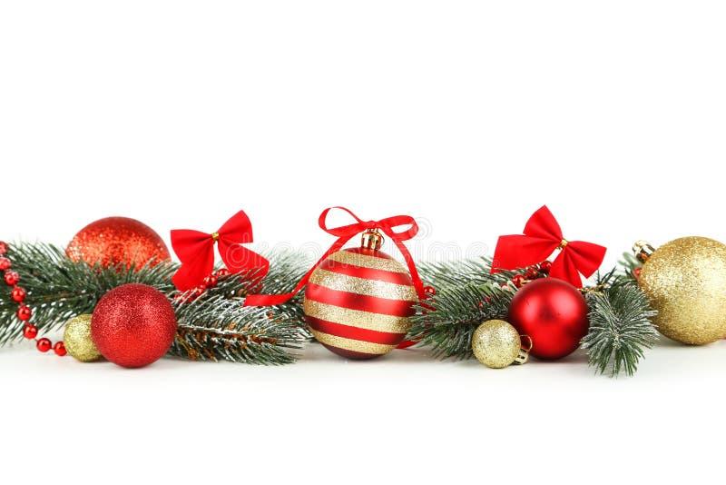 Filial av julgranen med bollar som isoleras på vit royaltyfria bilder