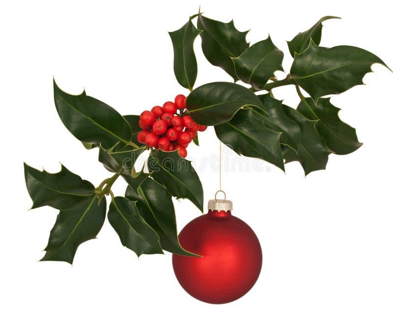 Filial do azevinho com decoração do Natal fotos de stock royalty free