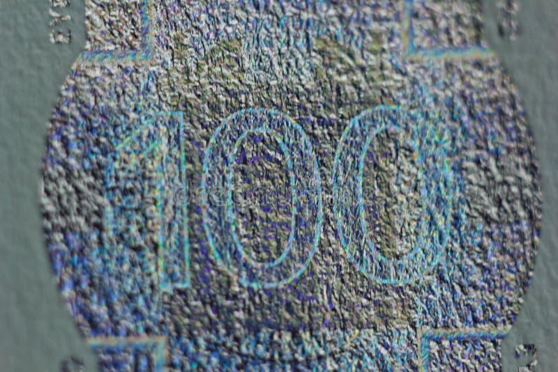 Filigrana protetora em cem contas do euro no macro proteção contra falsificar das cédulas hologram detalhe de papel fotografia de stock