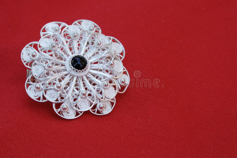 Filigree Brooch. Brooch hand-made of silver wires; filigree craftsmanship is a dying craft in Macedonia royalty free stock image