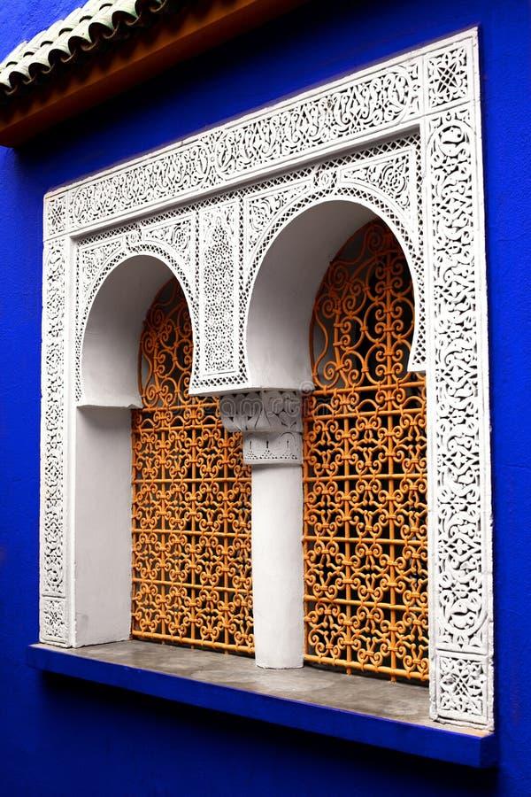 Filigree window. In the Jardin Majorelle in Marrakech stock photo
