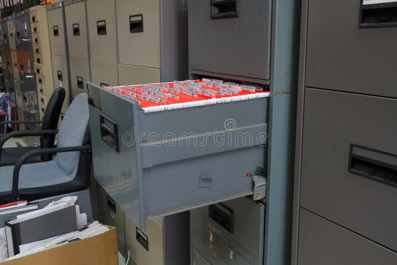 Filing cabinets. Red filing in the drawer of the filing cabinet royalty free stock photos