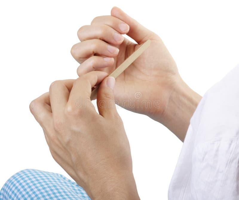 Filing nails royalty free stock photos