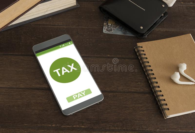 Filing taxes online. Using smartphones and the internet on mobile royalty free stock photography