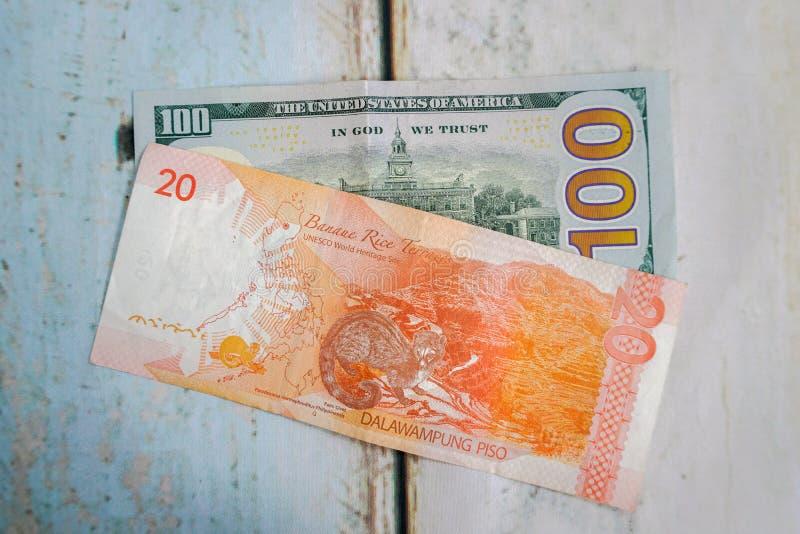 Filipiński peso i amerykanina dolar usd fotografia royalty free