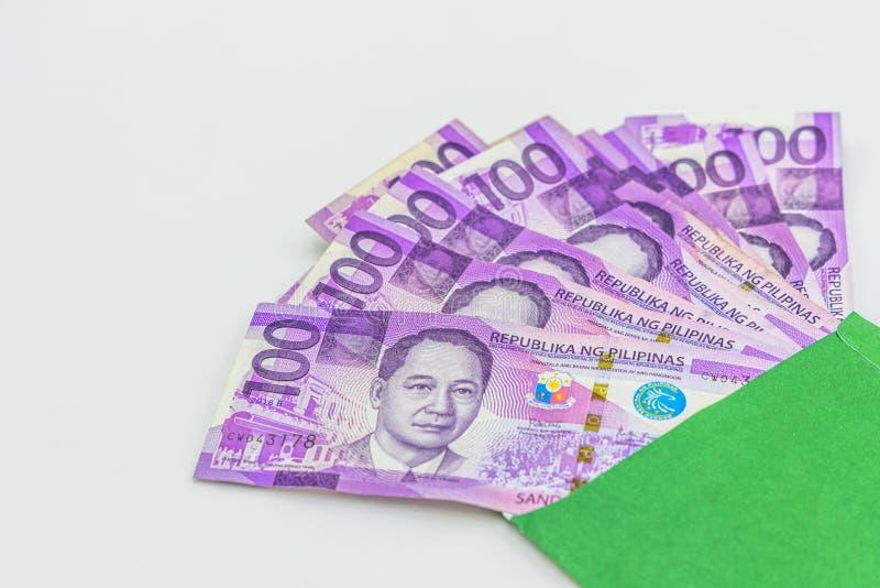 Filipi?czyk 100 peso rachunek, Filipi?ska pieni?dze waluta, Filipi?ski pieni?dzy rachunk?w t?o zdjęcia royalty free