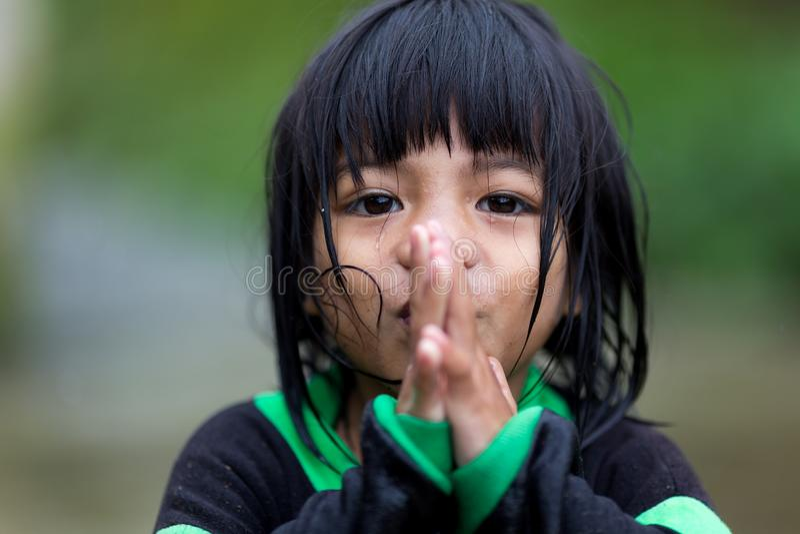 Filipina little girl praying royalty free stock photography