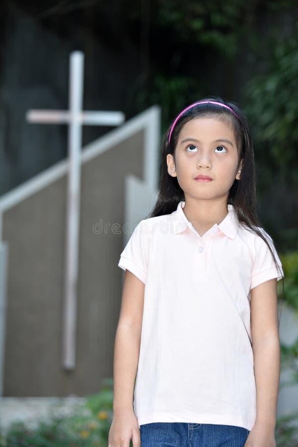 Filipina Person And Cross catholique apathique photographie stock