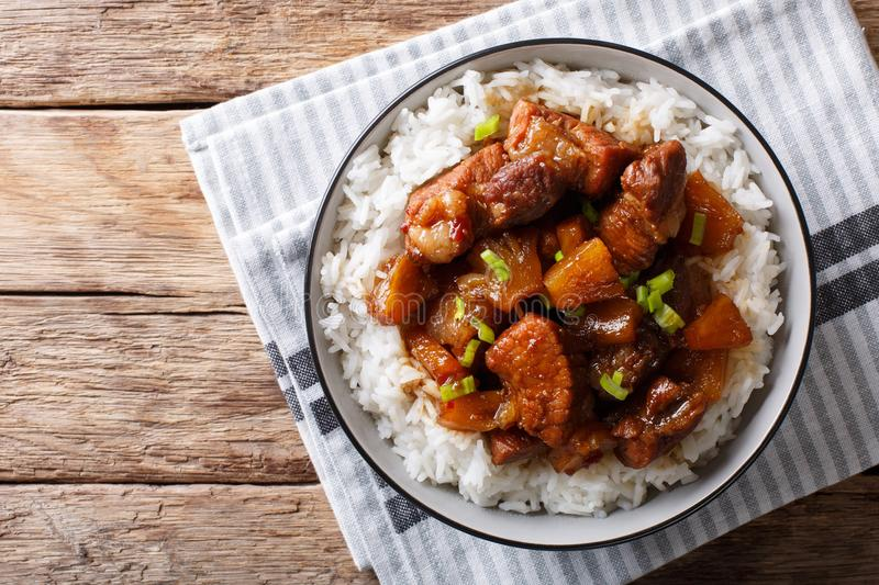 Filipino belly pork hamonado with pineapple and rice close-up. H royalty free stock photos