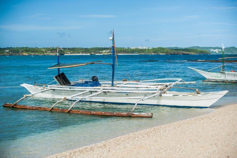 Filipino boat in the sea near the beauty beach at Boracay island royalty free stock images