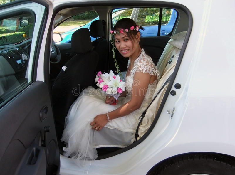 Filipino Bride In Car On Her Wedding Day. Photo Of Filipino Bride In Car On Her Wedding Day royalty free stock images