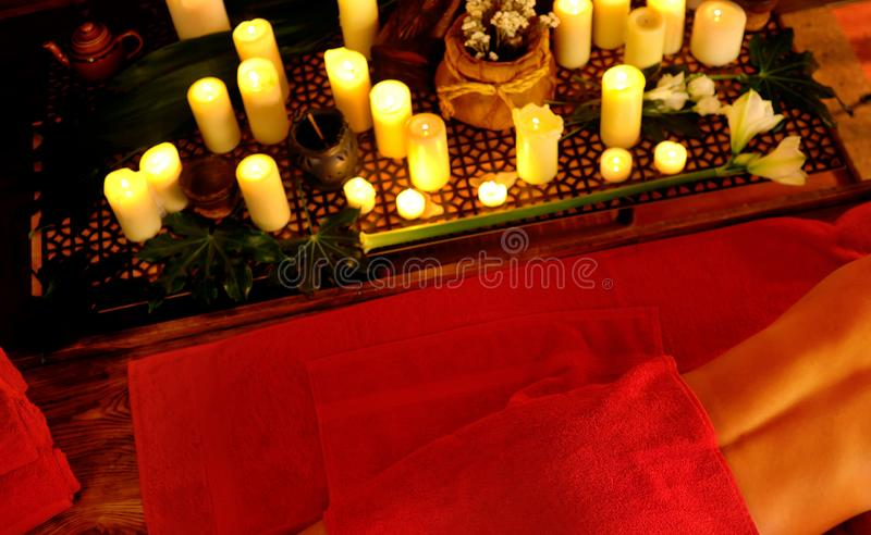 Filipino massage of woman in spa salon. Girl on candles background. royalty free stock photos