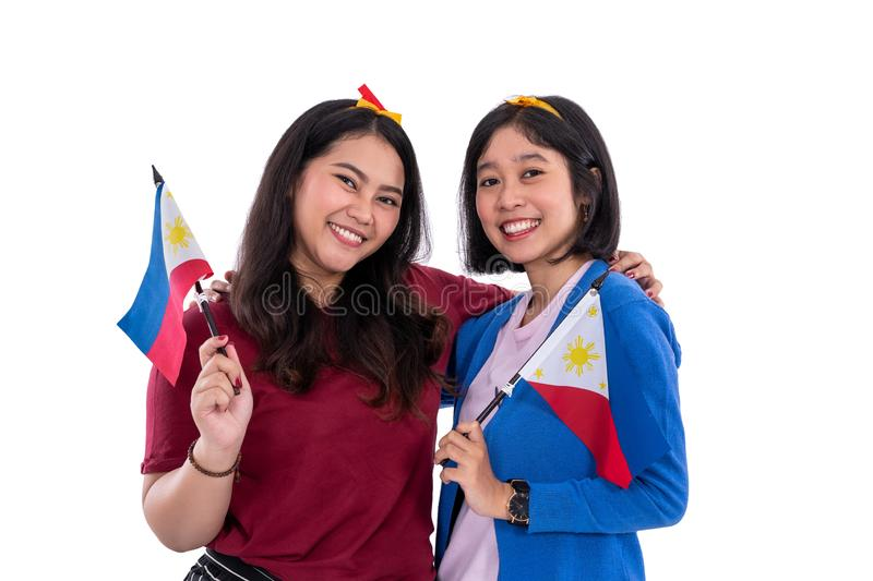 Filipino woman holding philippines national flag. Filipino women holding philippines national flag isolated over white background royalty free stock photos