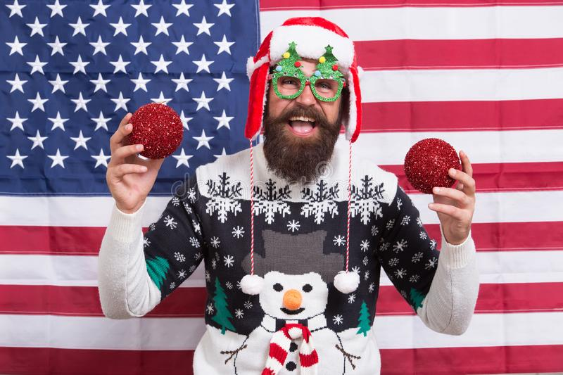 Fill home with decoration. Happy american santa. Bearded man hold glossy xmas decoration. Ball ornament and decoration royalty free stock photo