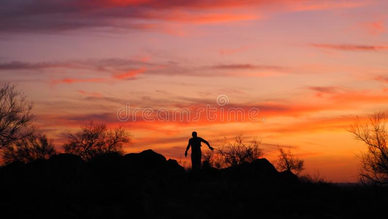 Fill Me In. The silhouette of hiker during the evening hours in the desert of phoenix arizon usa. Vgphotoz, illustration, clouds, sky, amazing, picture, foto royalty free stock image