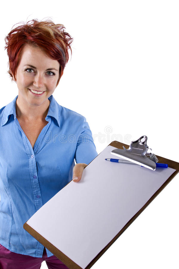 Fill Out Forms. Young female welcoming viewer with a clip board stock photography