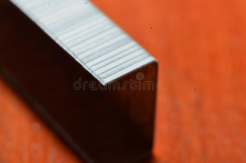 Fill the staples, made of silver silver in the shape of the letter u royalty free stock images