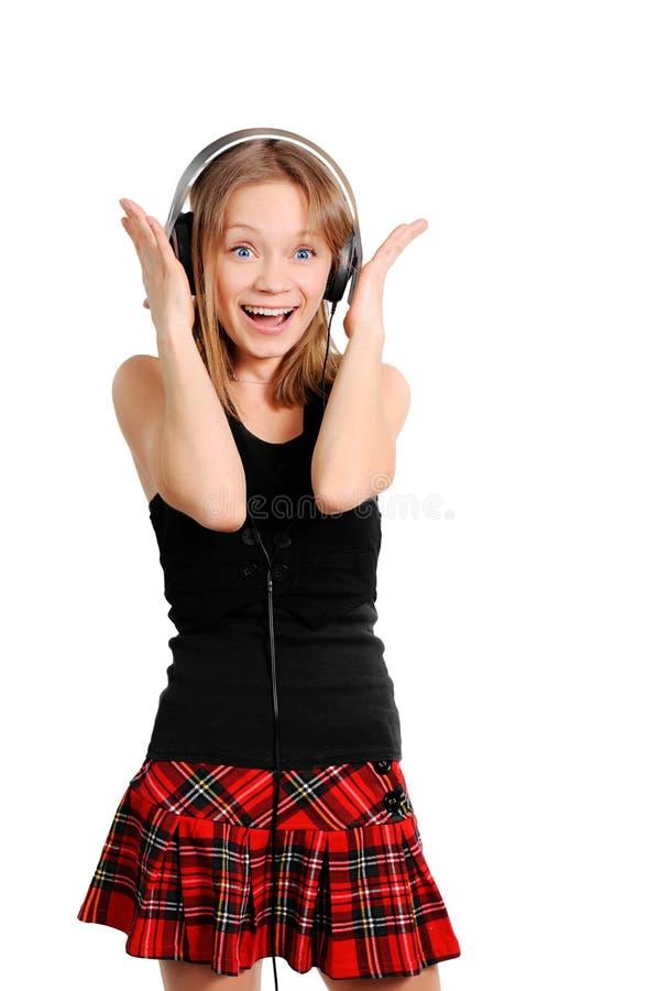 Fille écoutant la musique images libres de droits