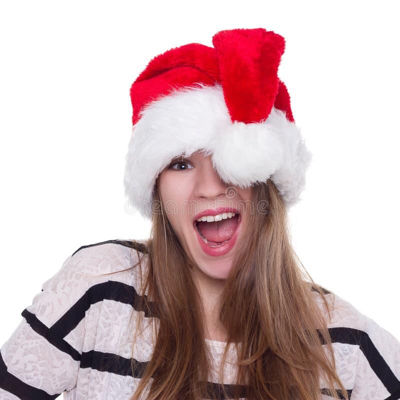 Fille émotive expressive dans un chapeau de Noël sur le fond blanc photographie stock libre de droits