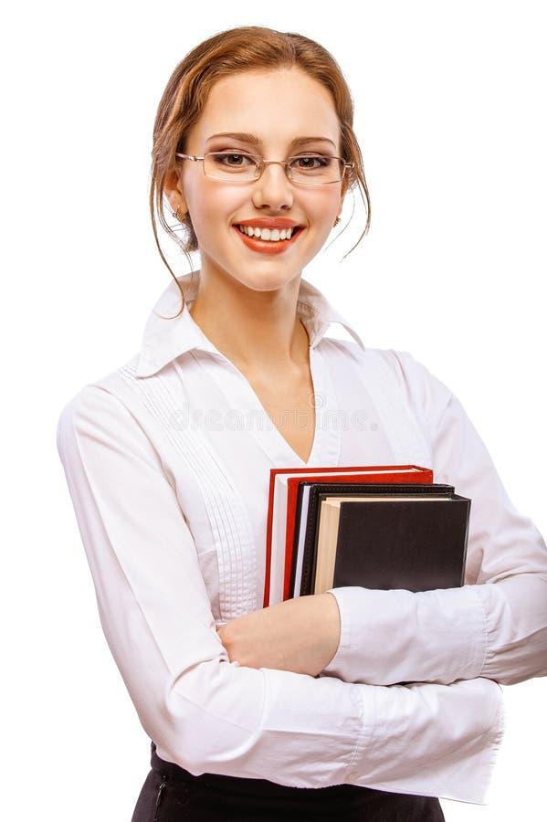 Fille-étudiant de sourire avec des manuels image libre de droits