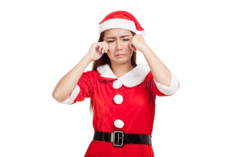Fille asiatique de Noël avec le cri de vêtements de Santa Claus image stock