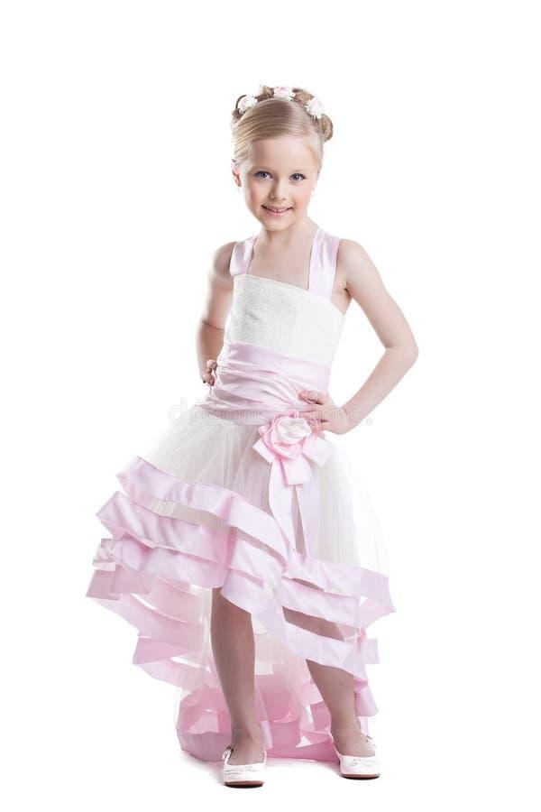 Fille assez petite dans la belle robe isoloated photographie stock