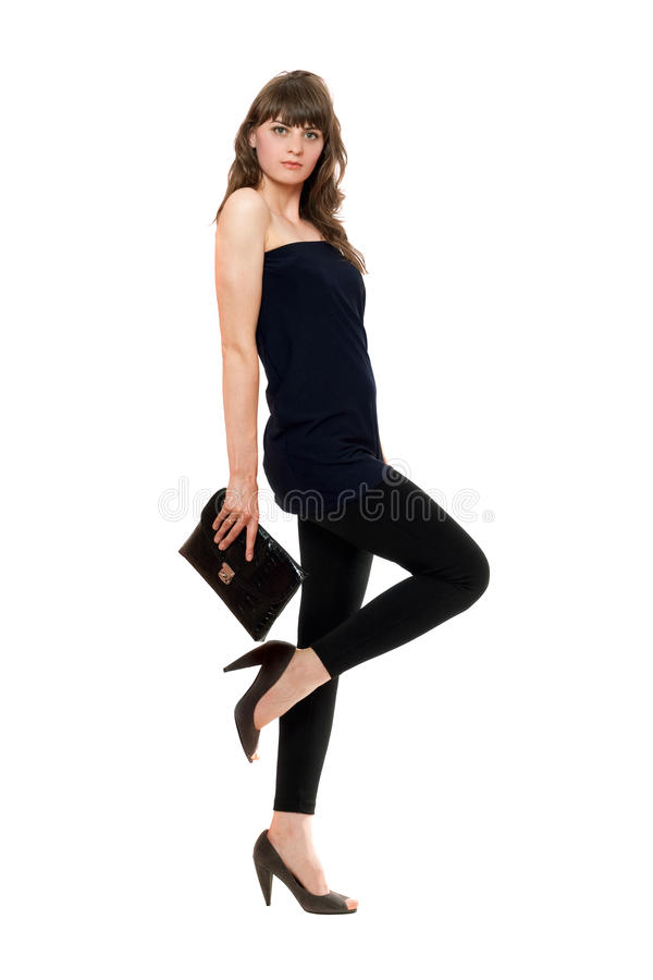 Fille attirante dans des guêtres noires avec un sac à main images libres de droits