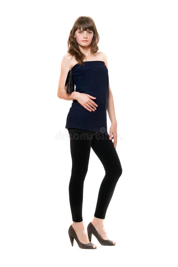 Fille attirante dans guêtres noires. D'isolement photo stock