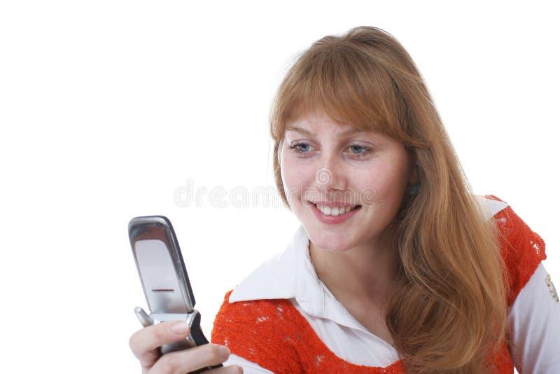 Fille au téléphone image stock
