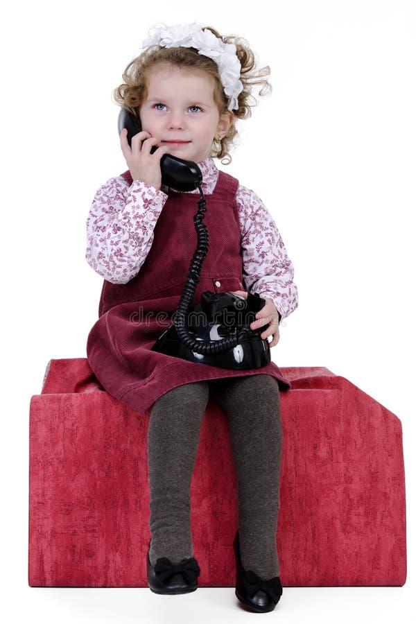 Fille au téléphone photo libre de droits