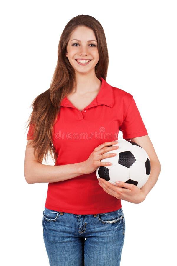 Fille mignonne tenant un ballon de football photographie stock